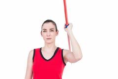 Atleta de sexo femenino Throwing una jabalina Fotos de archivo libres de regalías