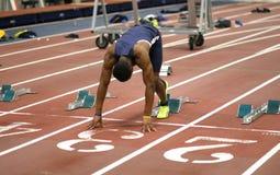 Atleta de sexo masculino en el césped Fotografía de archivo libre de regalías