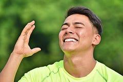 Atleta de sexo masculino Laughing de la minoría Imagen de archivo libre de regalías