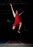 Atleta del salto de longitud fotografía de archivo libre de regalías