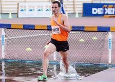 atleta di ßiepi di 3000 m. Immagini Stock