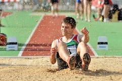 Atleta e sabbia di volo Fotografie Stock