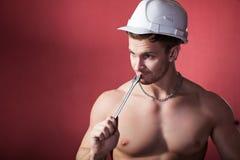 Atleta en el casco de la construcción Trabajo Fotografía de archivo
