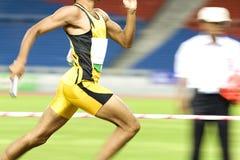 Atleta en la acción Fotografía de archivo libre de regalías