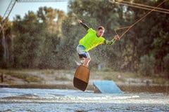 Atleta en un tablero en el lago Imágenes de archivo libres de regalías