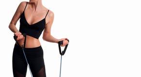 Atleta esile della donna che fa allenamento di forma fisica Immagini Stock
