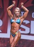 Atleta fêmea Curvy, Muscled Poses do físico em Toronto 2018 pro Supershow Fotos de Stock