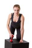 Atleta fêmea seguro que levanta olhando a câmera Imagens de Stock