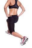 atleta femminile che fa la sua esercitazione d'allungamento Immagine Stock Libera da Diritti