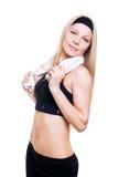 Atleta fino en un fondo blanco Foto de archivo