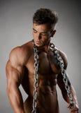 Atleta fuerte con la presentación perfecta del cuerpo desnuda Imagen de archivo