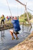 Atleta iść przez błota i wody Zdjęcia Royalty Free