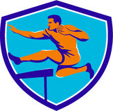 Atleta Jumping Hurdle do atletismo Fotografia de Stock