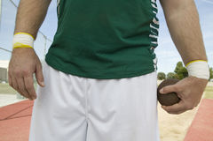 Atleta maschio Holding Shot Put Immagini Stock