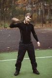 Atleta maschio maturo Stretching all'aperto Fotografie Stock Libere da Diritti