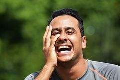 Atleta masculino Laughing imagem de stock