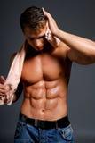Atleta mojado atractivo Imagenes de archivo