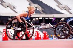 Atleta na cadeira de rodas no estádio 2012 de Londres Imagem de Stock