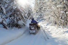 Atleta na snowmobile Obrazy Royalty Free
