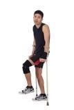 Atleta nepalês novo, muletas Foto de Stock Royalty Free
