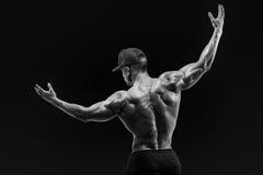 Atleta obraca z powrotem i wzrasta oba ręki Fotografia Stock