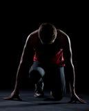 Atleta pronto ad iniziare immagini stock