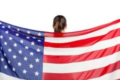 Atleta que presenta con la bandera americana después de la victoria Fotografía de archivo libre de regalías