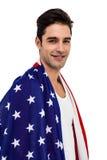 Atleta que presenta con la bandera americana después de la victoria Fotografía de archivo