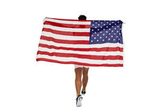 Atleta que presenta con la bandera americana después de la victoria Imagenes de archivo