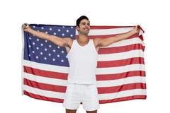 Atleta que presenta con la bandera americana después de la victoria Fotos de archivo libres de regalías