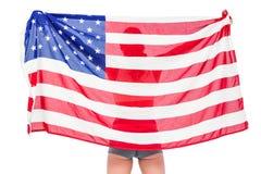 Atleta que presenta con la bandera americana después de la victoria Foto de archivo libre de regalías