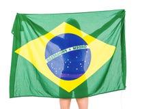 Atleta que presenta con la bandera brasileña después de la victoria Fotos de archivo libres de regalías