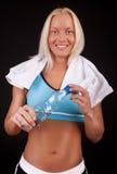 Atleta sonriente con la botella Fotos de archivo