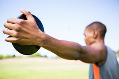 Atleta trzyma dyska Obrazy Stock