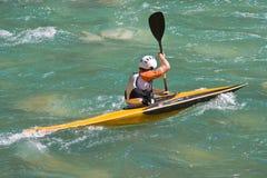Atleta in una canoa Fotografie Stock Libere da Diritti