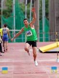 atleta współzawodniczy skok trójkę Obrazy Stock