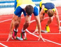 Atletas no início Fotografia de Stock