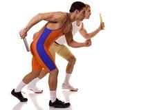 Atletas que competem o relé Imagens de Stock Royalty Free