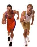 Atletas que competem o relé Foto de Stock Royalty Free