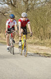 Atletas que montam ciclos Imagens de Stock Royalty Free