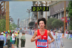 Atleten in de marathon Stock Afbeelding