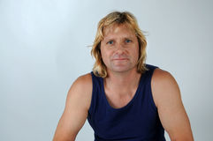 Atlethic man. Atlethic good looking  blond  man with blue tank-top Stock Photography