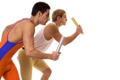 Atleti che corrono relè Fotografie Stock