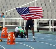 Atleti dopo le transenne dei 400 tester finali Immagine Stock