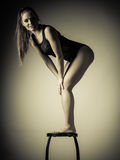 Atletic woman fit slim body posing Royalty Free Stock Image