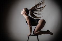 Atletic woman fit slim body posing Royalty Free Stock Photography