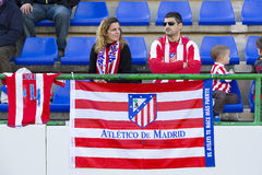 Atletico de Madrid supporters. Two unidentified supporters at Spanish Cup match between Sant Andreu and Atletico de Madrid, final score 0-4, on December 7, 2013 Royalty Free Stock Photography