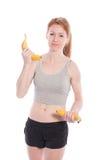 Atletisch meisje met in hand bananen Royalty-vrije Stock Foto's