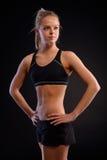 Atletisch meisje in sportkleding royalty-vrije stock fotografie