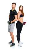 Atletisch paar - man en vrouw met domoren op het wit Stock Afbeeldingen